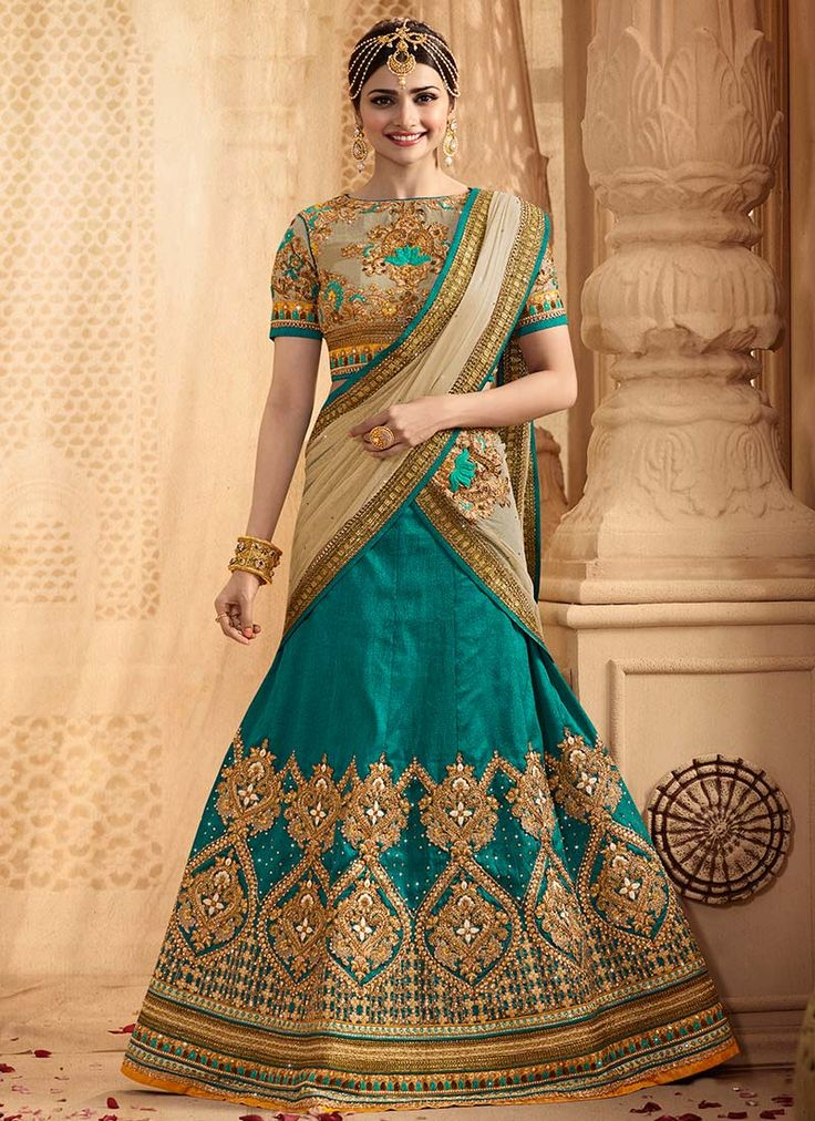 Buy Prachi Desai Blue Shade A Line Lehenga online from the wide collection of a-line-lehenga.  This Blue  colored a-line-lehenga in Art Silk  fabric goes well with any occasion. Shop online Designer a-line-lehenga from cbazaar at the lowest price.