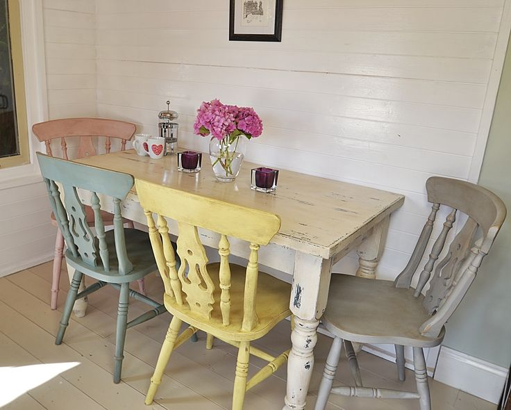 This fabulous dining set has four pastel chairs painted in Duck Egg Blue, Paris Grey, Antoinette and Yellow.  The table is in Original White with gunmetal grey showing through underneath.  The whole set is painted with a textured effect and heavily aged and distressed with dark wax.