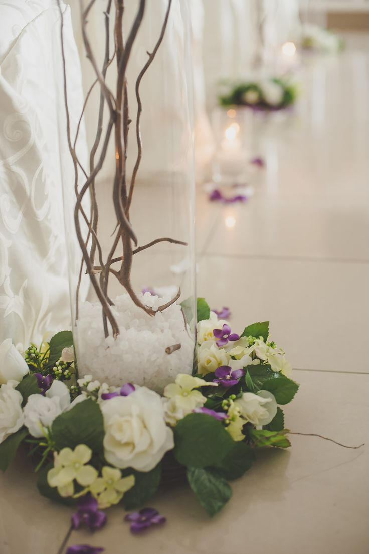 Floral bases to the tall glass cylinders #WeddingDecor