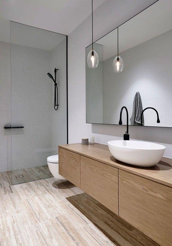 Lighting Inside The White Contemporary Bathroom Is Kept Minimal