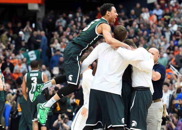Rich Barnes-USA TODAY Bryn Forbes (5) celebrates after the game against the Louisville Cardinals in the finals of the east regional of the 2015 NCAA Tournament at Carrier Dome. Michigan State Spartans won 76-70.
