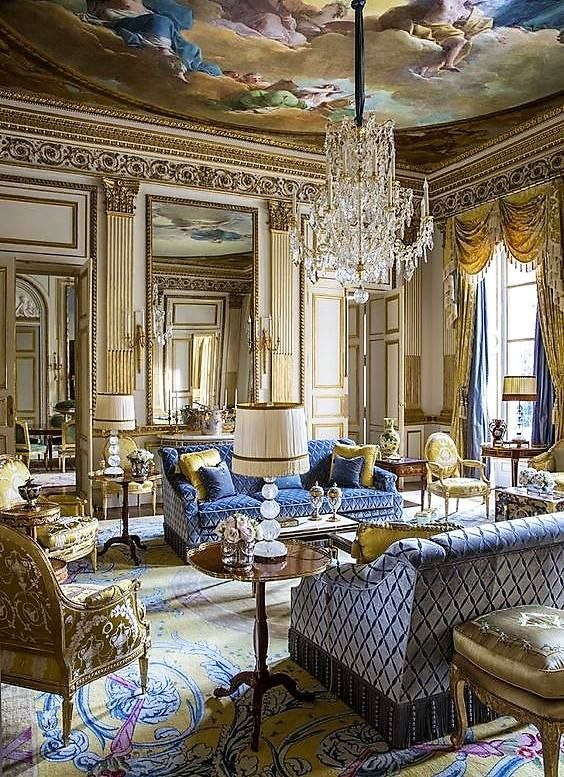 Magnificent French style salon in blue and gold with a painted ceiling.