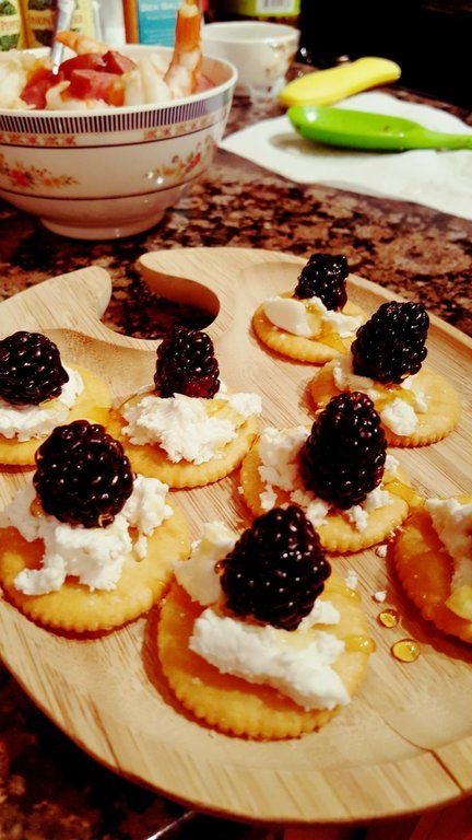 Ritz crackers, goat cheese, blackberries, and a dr…