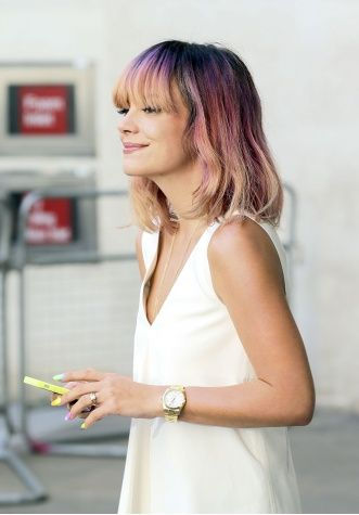 Lily Allen's latest take on colourful hair: a cool ombré mix of violet, rose, and apricot.