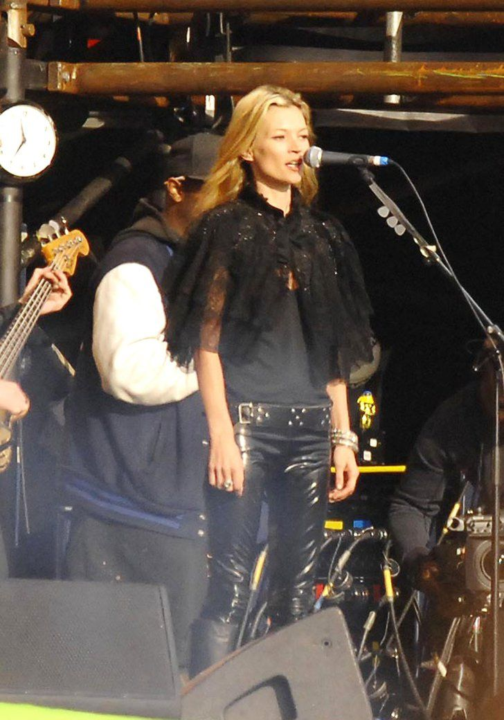 Pin for Later: Kate Moss, Patron Saint of Glastonbury Style  For a spot on stage with then-boyfriend Pete Doherty's band, Kate went for the rock-chick look with skinny leather jeans and a capelet.