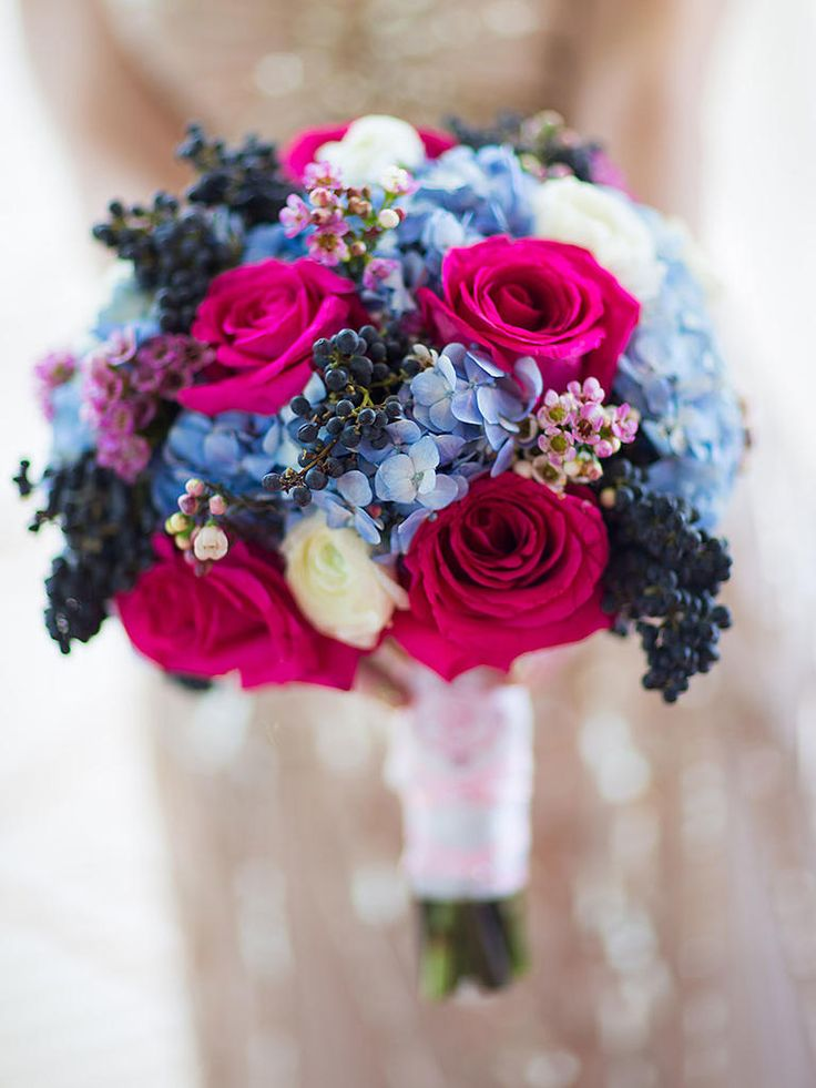 Create a jewel-toned bouquet by mixing roses, hydrangea, wax flower and dark viburnum berries.