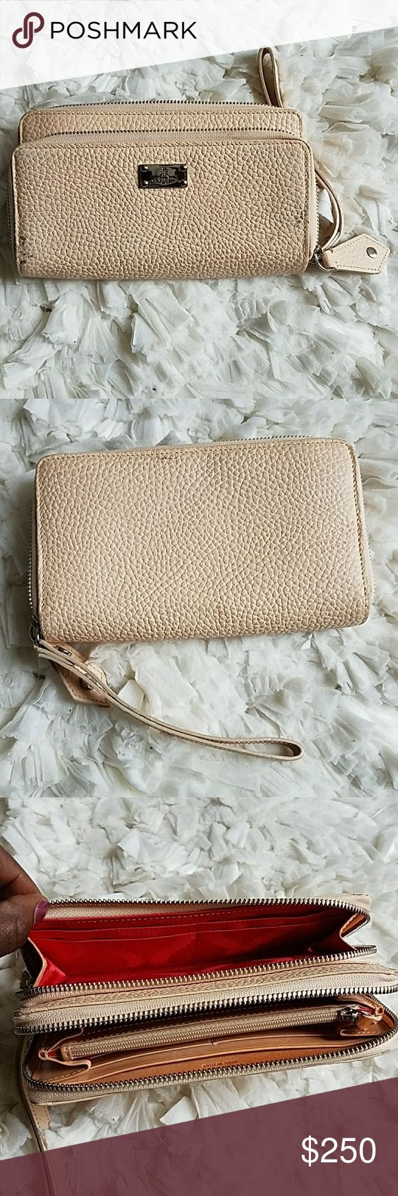 "GORGEOUS Vivienne Westwood Wrislet/Wallet 4.5"" × 7.5"" x 1.5"" Cream textured leather Double zip wallet cassis 8-card slot in small single-compartment  12-card slot in large 5-compartment  Original $742, bought on sale $325 Signs of natural oxidation on 100% leather, but exterior still in good condition. Pic 8 shows the wear on wallet exterior. Interior is in excellent condition & mark/stain free.   I am totally obsessed with this wallet! Firm price!   🛇Holds 🛇Trades 🛇Offers  YES AUTHENTIC…"