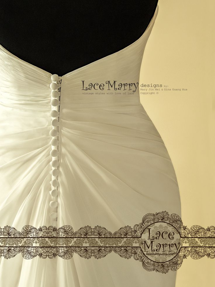 A Row of Covered Buttons on the back is adding a touch of Vintage! Perfect choice for Beach Summer Wedding!!!