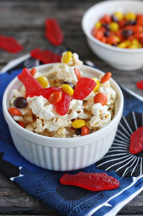 "<p>Pass around the popcorn bowl once the show starts. Just make sure it is filled with shark bait popcorn first. <a href=""http://notyourmommascookie.com/2013/08/shark-week-shark-bait-popcorn/"" target=""_blank"">Get the recipe here.</a></p>"