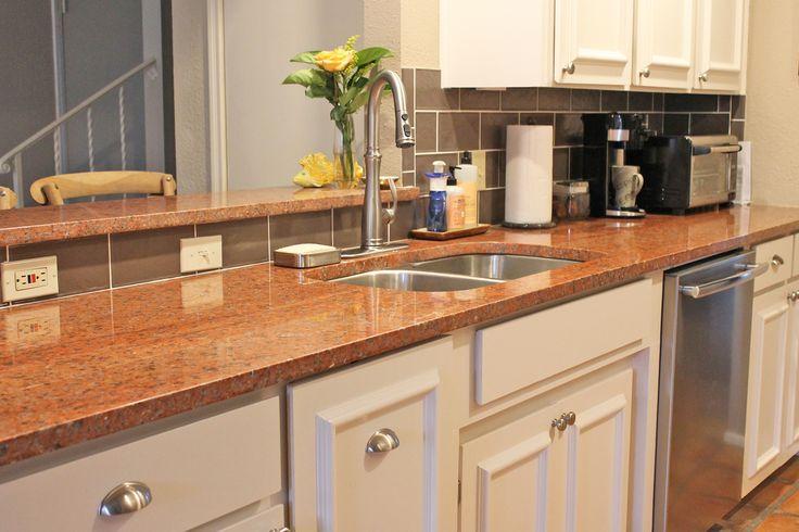 kitchen design with terra cotta red granite countertops