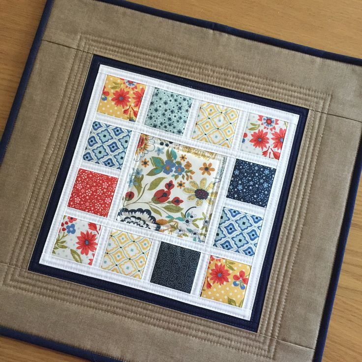 Floral Modern Table Topper, Quilted Table Topper, Fabric Table Runner, Square Quilted Candle Mat, Mini Patchwork Wall Quilt, Table Mat by SewnByVicki on Etsy https://www.etsy.com/uk/listing/600078527/floral-modern-table-topper-quilted-table
