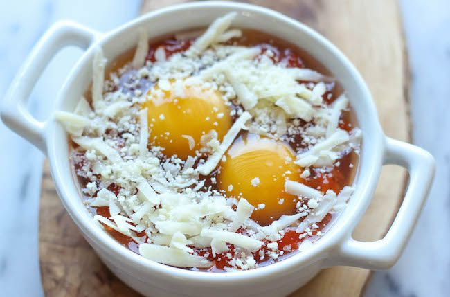 Italian Baked Eggs - You'll never believe that these marinara cheesy baked eggs can be made in just 10 minutes for a complete breakfast!