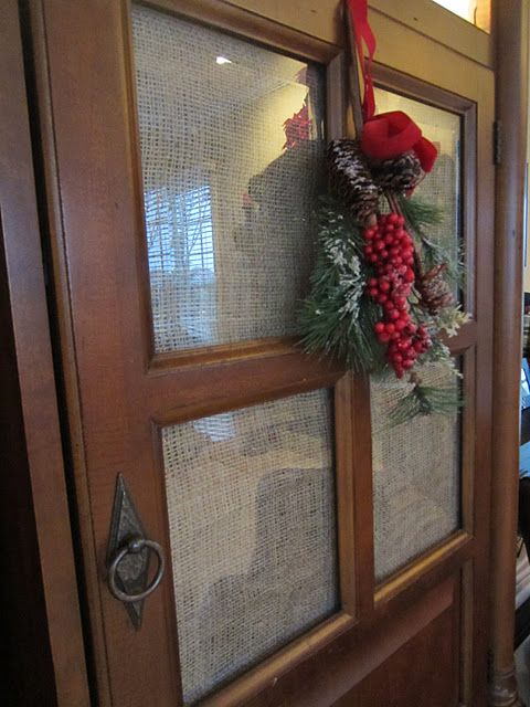 Use burlap on glass entertainment center doors to hide clutter (great idea for glass doors anywhere in house).