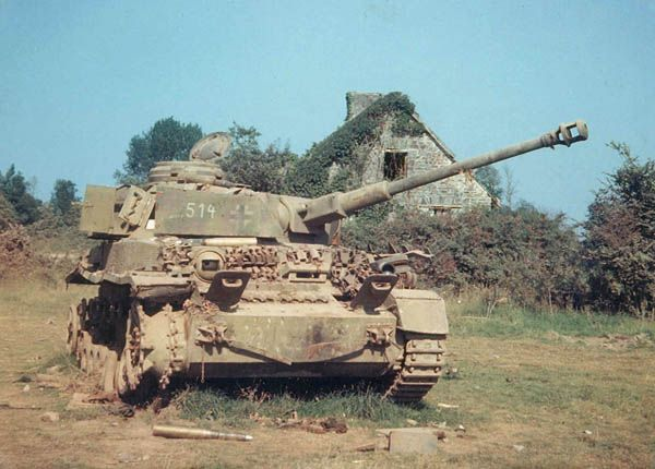 Rare color photograph of a camouflaged Panzer IV knocked out in Normandy in 1944. From the markings and camouflage, the Panzer IV appears to be from the German Panzer Lehr Division. U.S. Air Force Photo.