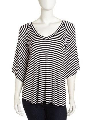 Striped jersey. V neckline. Batwing sleeves. Relaxed fit. Shirttail hem; pullover style. Rayon/spandex; machine wash. Imported.