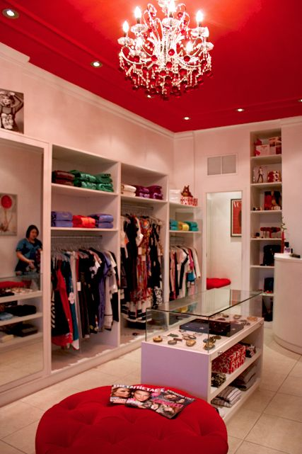 I'm not sure if this is a store or a closet but it's definitely good closet inspiration! I love the red ceiling and ottoman!