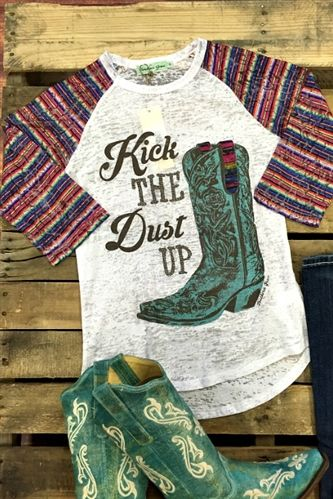 Our Kick The Dust Up Baseball Tee is the perfect shirt for Luke Bryan fan in you! This shirt features a scoop neck with quarter length serape pattern sleeves. The front features the words ' Kick The Dust Up' and a teal cowboy boot.