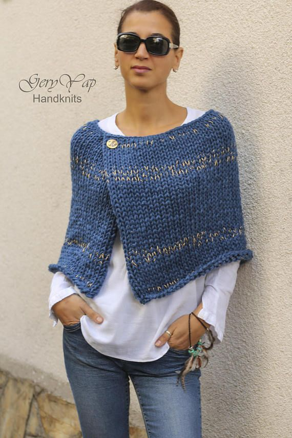 This warm poncho is hand knitted by me of thick woolen yarn in denim blue color with golden threads. The poncho has a decorative button close to the neckline. It is so soft and cosy that you`ll really love it! This hand made garment is perfect for the autumn chily mornings and evenings