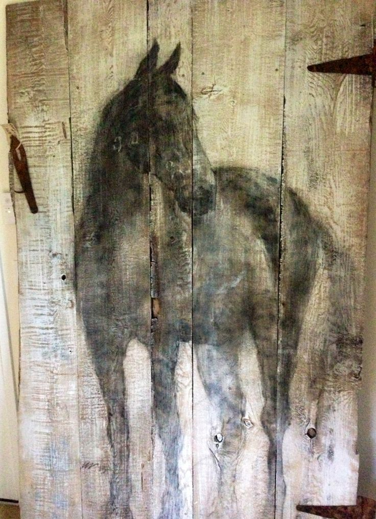 Old barn door used as a painters pallet. How beautiful is this?