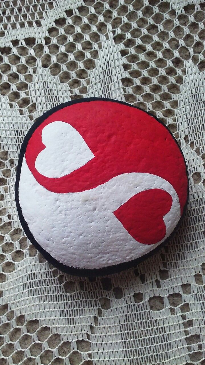 Heart's ying yang, painted on a Lake Huron beach stone by Cindy P 2018.