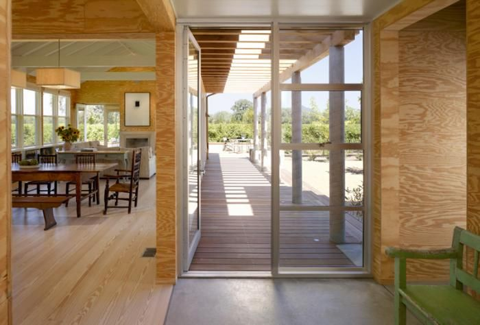 The-Architect-is-In-Nick-Noyes-Architecture  south-facing doors are protected from the strong summer sun by an exterior trellis. In the winter months, the low angle of the sun allows the light to come through under the trellis.
