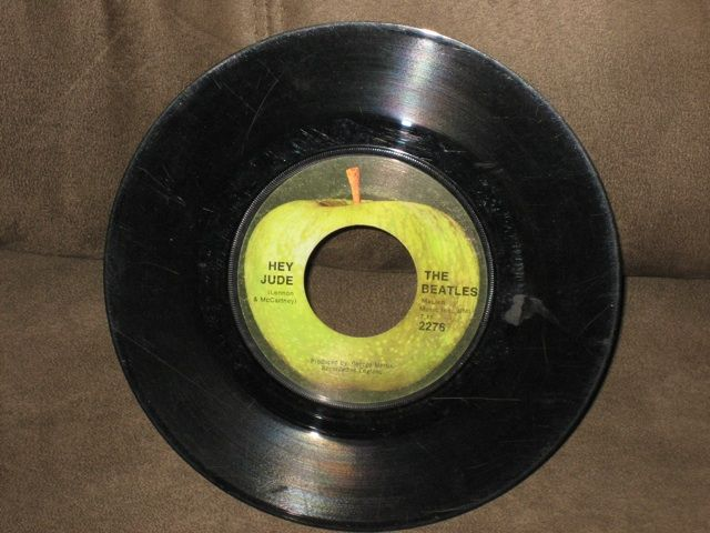 45 RPM records- this one is either the Beatles or another band that the Beatles had record on their record label like Badfinger.
