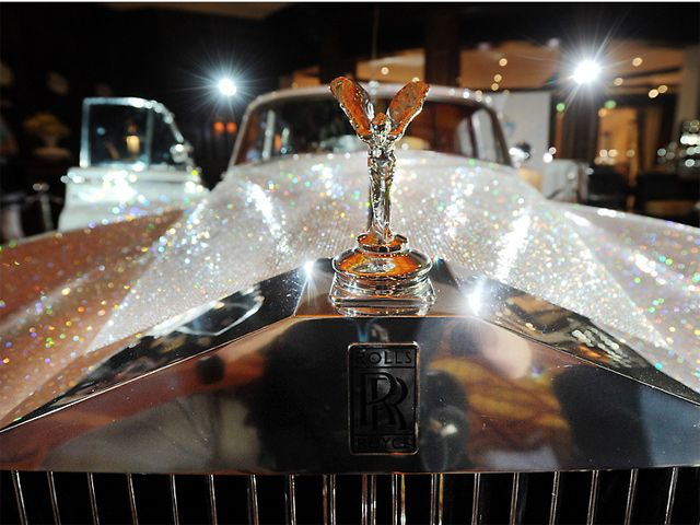 The Rolls- Royce Silver Cloud was built from 1955 until 1966 and this second generation model is powered by a 6.2-liter V8 and it weighs 2.11 tons (sans crystals). It has a top speed of roughly 144 mph and includes features such as power steering and windows, both of which were reserved only for uber luxury cars of the time. Covered in about 1,000,000 Swarovski crystals.