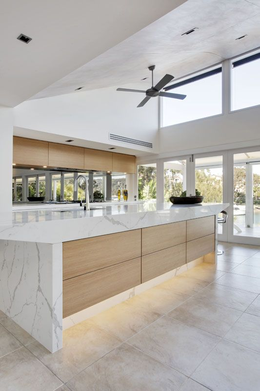 Kitchen with a sculptural Island paired with American Oak highlights - Newport