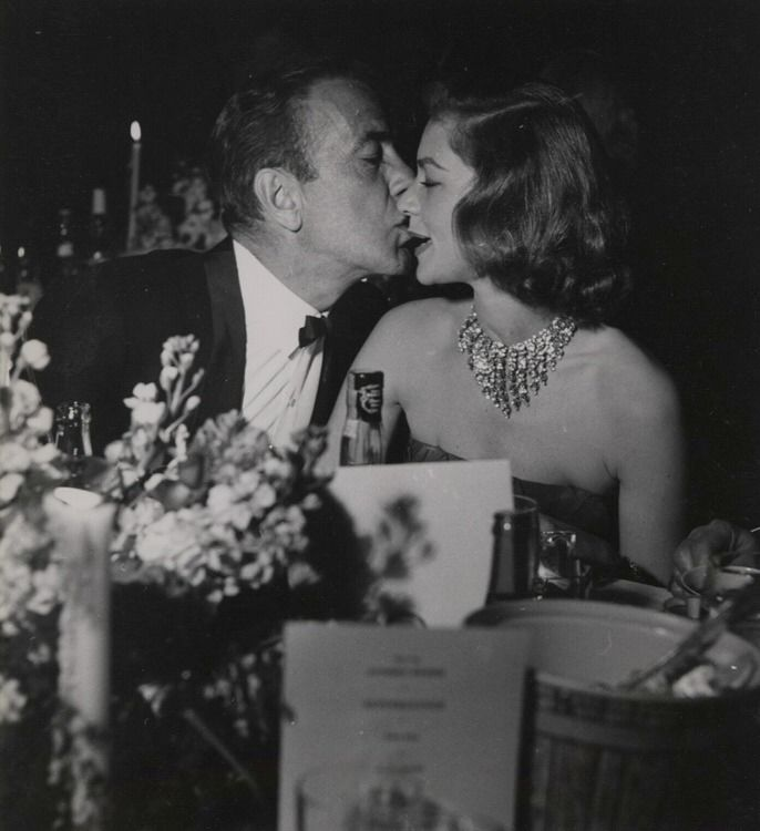 Humphrey Bogart and Lauren Bacall at a party following the