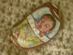 Painted rock,painted stone,Baby in bed,Basket baby,Pug,Sleepy child,yawning baby,Crib,Pug puppy,Shower gift,new mother,hand painted,nap time