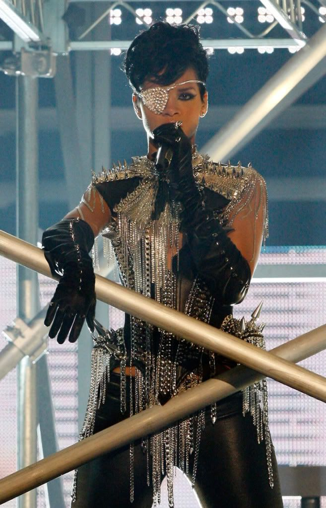 Rihanna 2008 AMAs. Alexander McQueen stretch leather high boots and spiked corset with hanging chains by The Blonds. Explore Omni Floyd's photos on Photobucket.