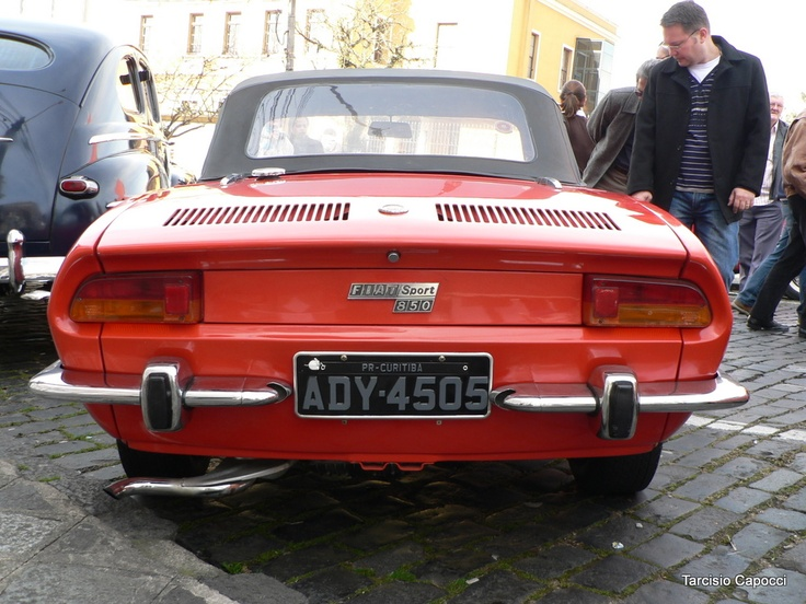 I had a red Fiat 850 Sport Spider back in high school. Wish I knew how to work on it back then.