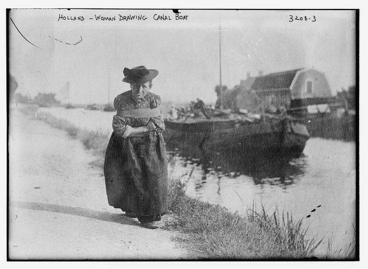 Woman pulling a canal boat Holland | c 1910