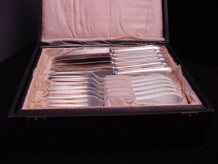 antique case with 24 pieces WMF knives and forks