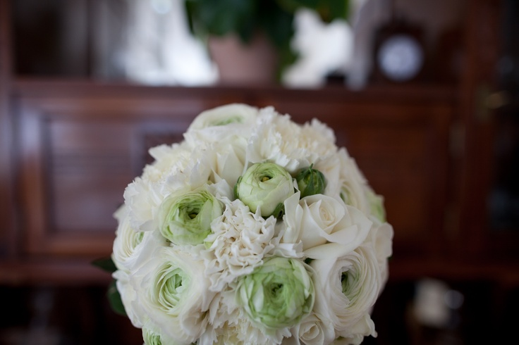white buttercups, carnations, roses.