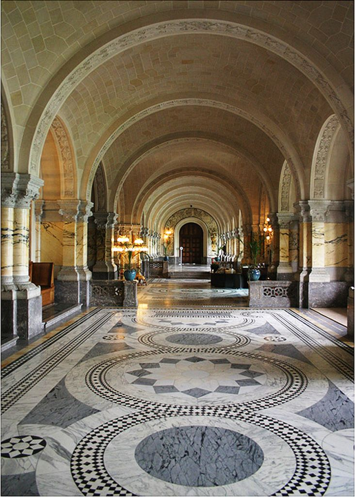 Main hall of ' The Peace Palace ' at The Hague, Netherlands. The background is the entrance of the Courtroom of the 'International Court of Justice' where people who commit Crimes Against Humanity are tried in the Court-of-Law.