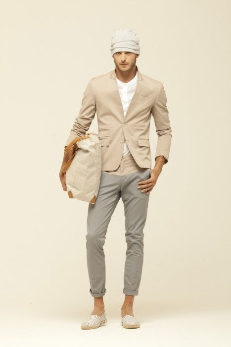 Team a tan blazer with grey chinos to achieve a dressy but not too dressy look. Want to go easy on the shoe front? Rock a pair of cream canvas espadrilles for the day.   Shop this look on Lookastic: https://lookastic.com/men/looks/blazer-henley-shirt-chinos-espadrilles-tote-bag-beanie/12274   — Beige Beanie  — Beige Henley Shirt  — Tan Blazer  — Beige Canvas Tote Bag  — Grey Chinos  — Beige Canvas Espadrilles