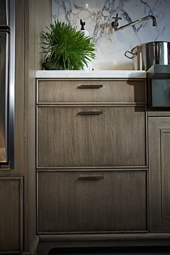 Rosedale Restoration - rift sawn white oak cabinets. Love the simple detail on the solid beaded drawer fronts with Bruxelles shaker door style. Simple hardware.