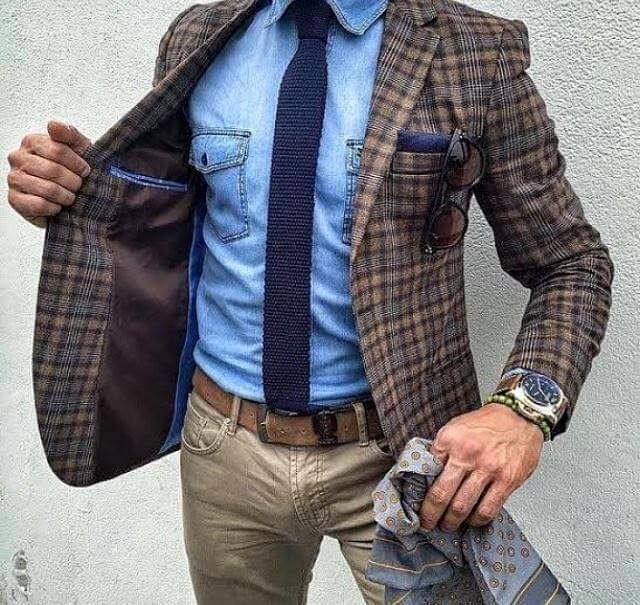 hot mens brown jacket over a blue shirt