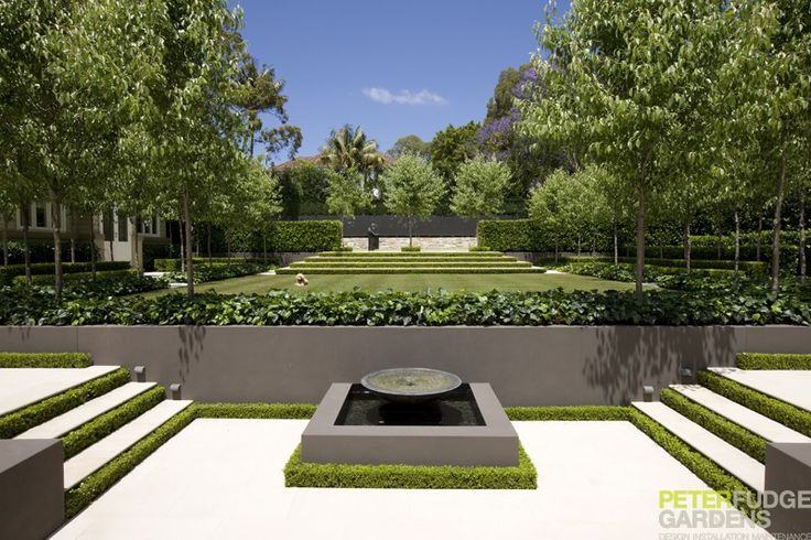 small hedge around fountain is a beautiful detail
