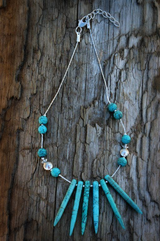 This is one of my favorite necklaces because it is both: edgy and simple. It is made of turquoise gemstone and silver tone chain and actually you can see silver tone fish in there as well. Does this all remind you beach? :)