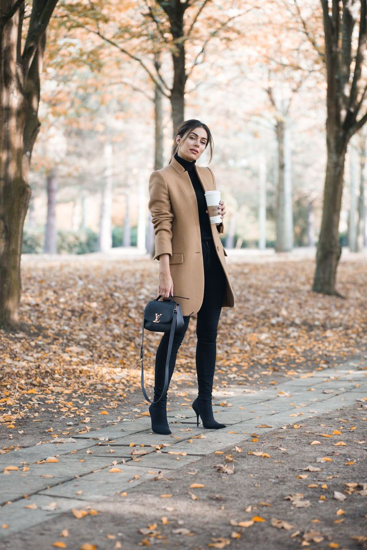 All black outfit and camel coat