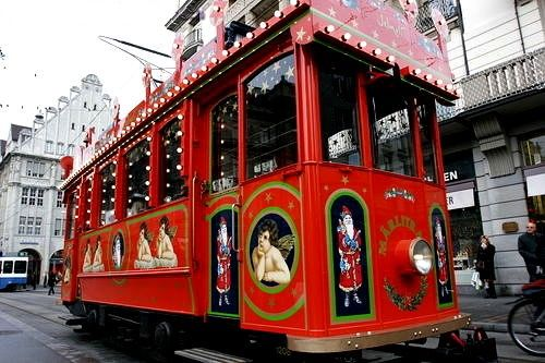 In Zurich, Santa visits in a special fairytale tram and gives the children a ride through the city, singing songs with them and sharing a basket full of sweets.