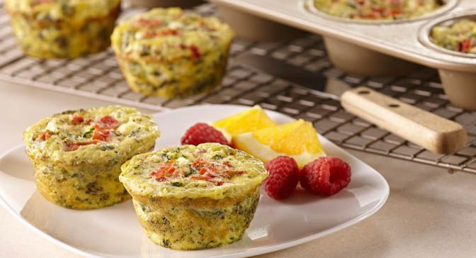Rather than make one large frittata on top of the stove, bake individual ones in a muffin tin. These colorful mini vegetable frittatas have great flavor from the Cheddar and goat cheeses and the Italian Seasoning.