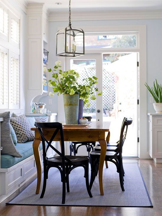 I love this casual eating banquette area. Great idea pulling up the table to the built-in window bench.