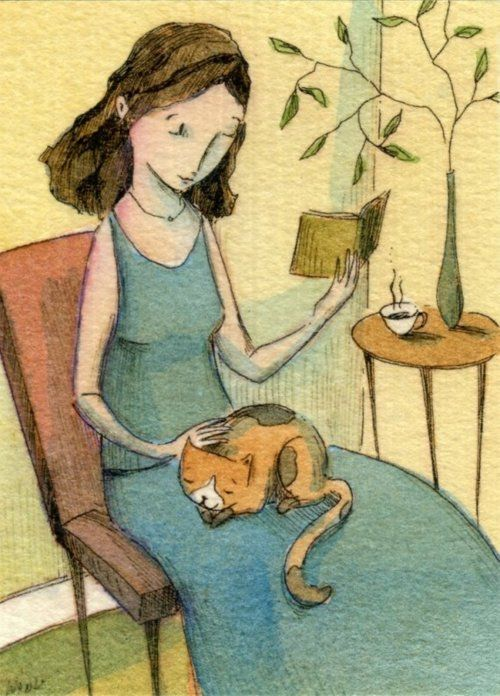 woman reading with a sleeping cat on her lap