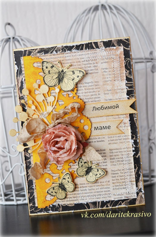 collage card with distressed book paper, butterflies, artifical flower an some dicuts in an artful arrangement...