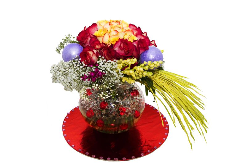 The Merry & Bright Bouquet is a charming display of cheer. Vibrant Equador Iguazu Red Roses and Yellow ones as the top centre part of the arrangement create a stunning look with clear glass filled with clear jellies and small red balls to accentuate the whole bouquet. This bouquet is guaranteed to make someone's day merry & bright.