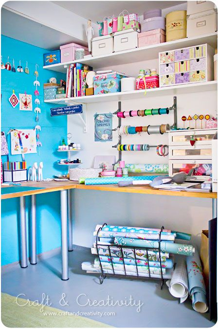 The high shelves with storage boxes above the craft table will be good use of the wall space.  MUST do this.