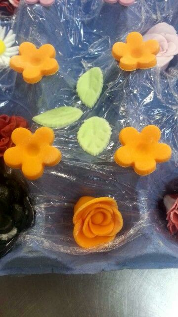Sugarpaste flowers and leaves.